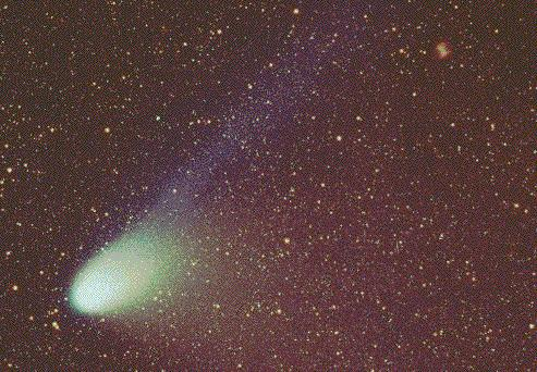 Comet Hale-Bopp and the Dumbbell Nebula