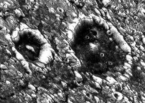 Dark Craters on Ganymede