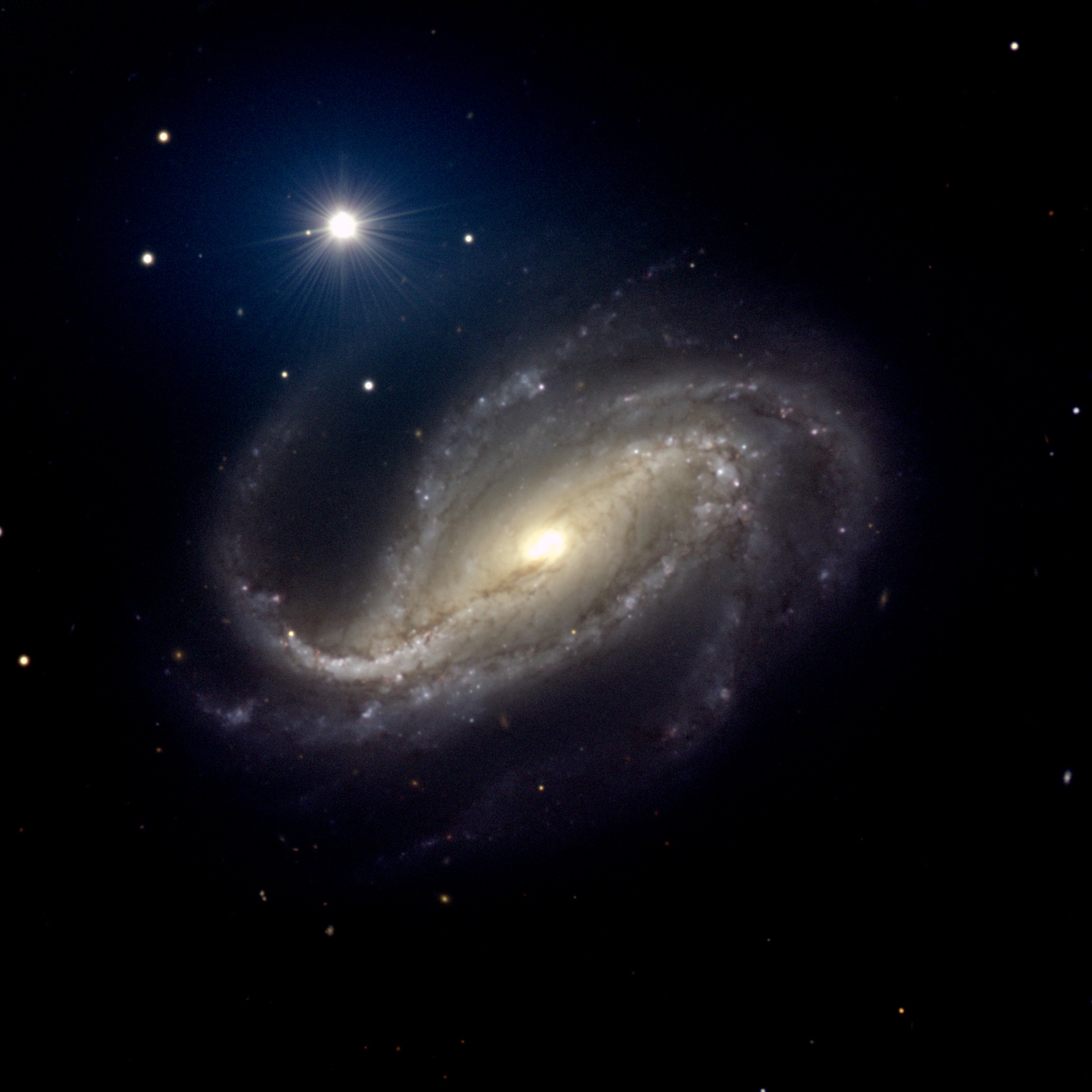 NGC 613: Spiral of Dust and St...