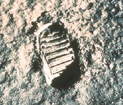 Neil Armstrong setting first foot on the Moon