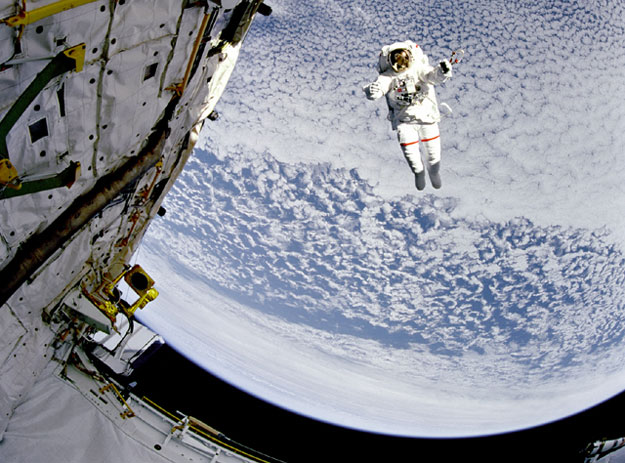 A Flying Astronaut Over Earth