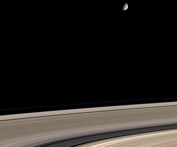 Saturn: Dirty Rings and a Clean Moon