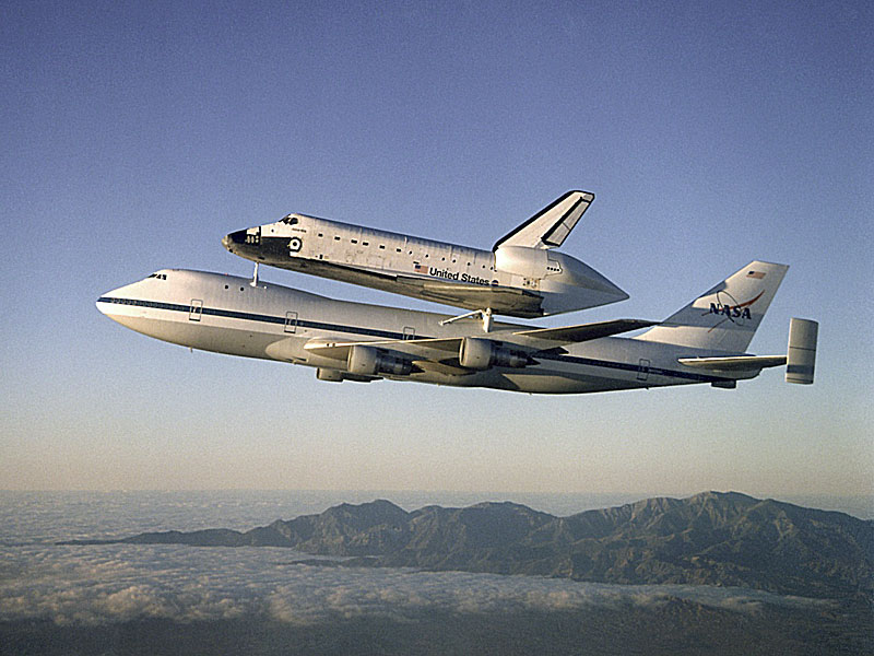 NASA operates two commercial Boeing 747 airplanes modified to carry a space