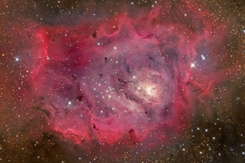 The Lagoon Nebula in Gas, Dust, and Stars