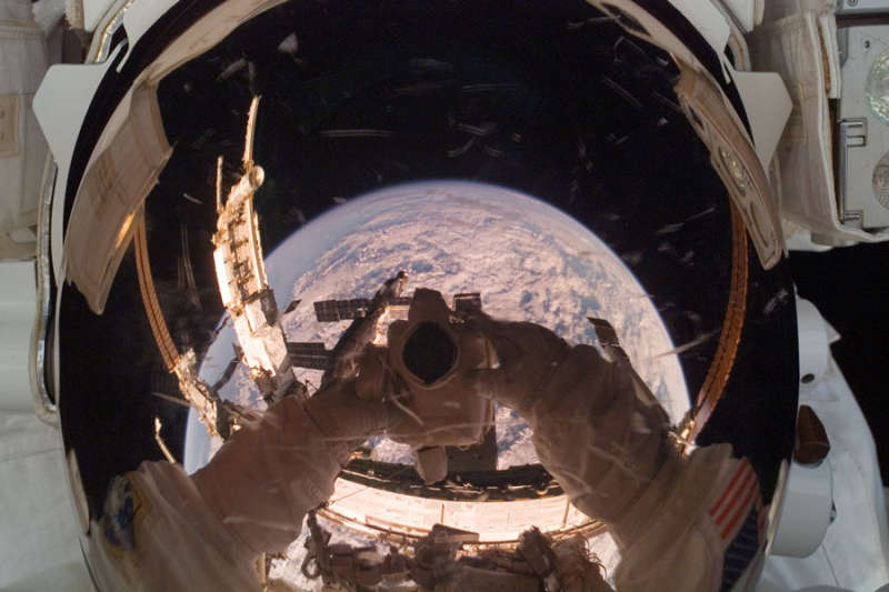 Orbiting Astronaut Reflects Earth