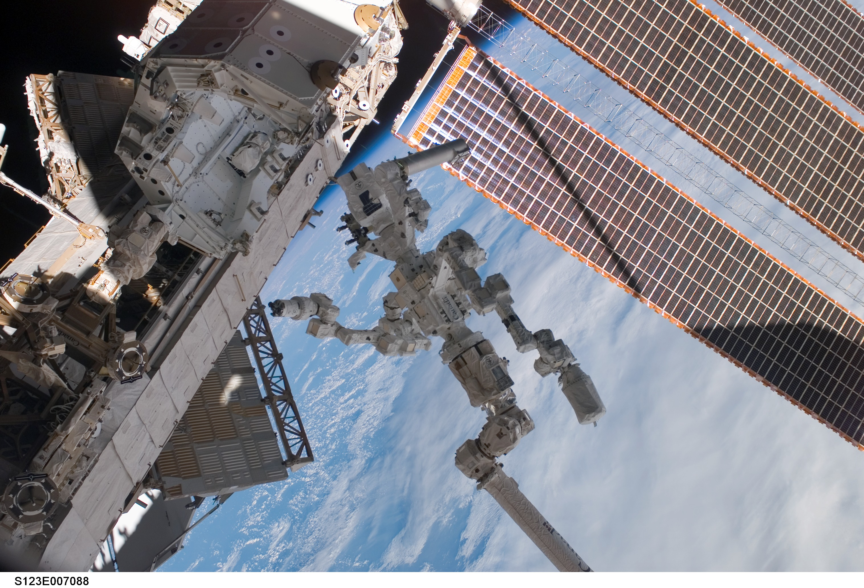 APOD: 2008 April 1- New Space Station Robot Asks to be Called Dextre the Magnificent