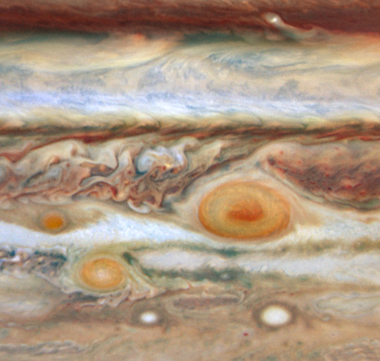Jupiter s Three Red Spots