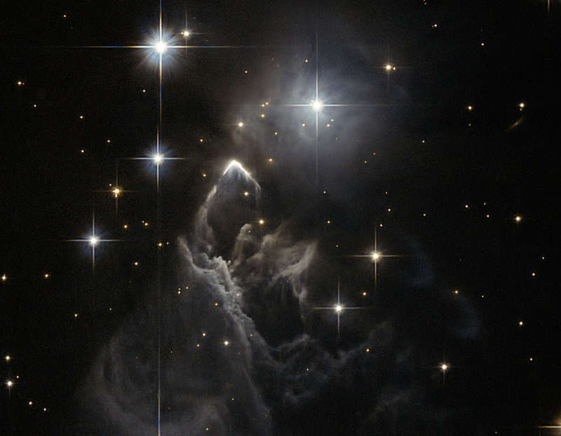 IRAS 05437 2502: An Enigmatic Star Cloud from Hubble