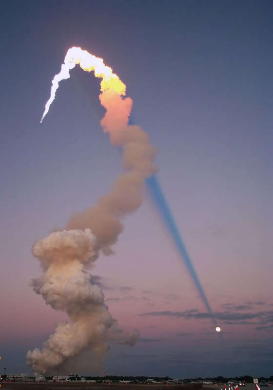 Shuttle Plume Shadow Points to the Moon