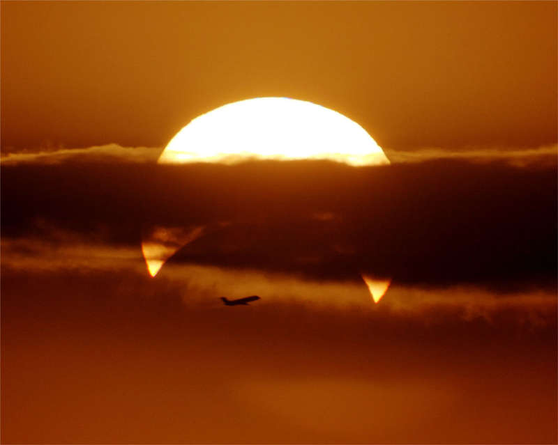 Partial Solar Eclipse with Airplane