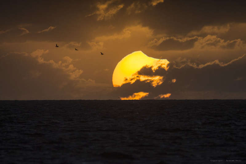 A Partially Eclipsed Setting Sun