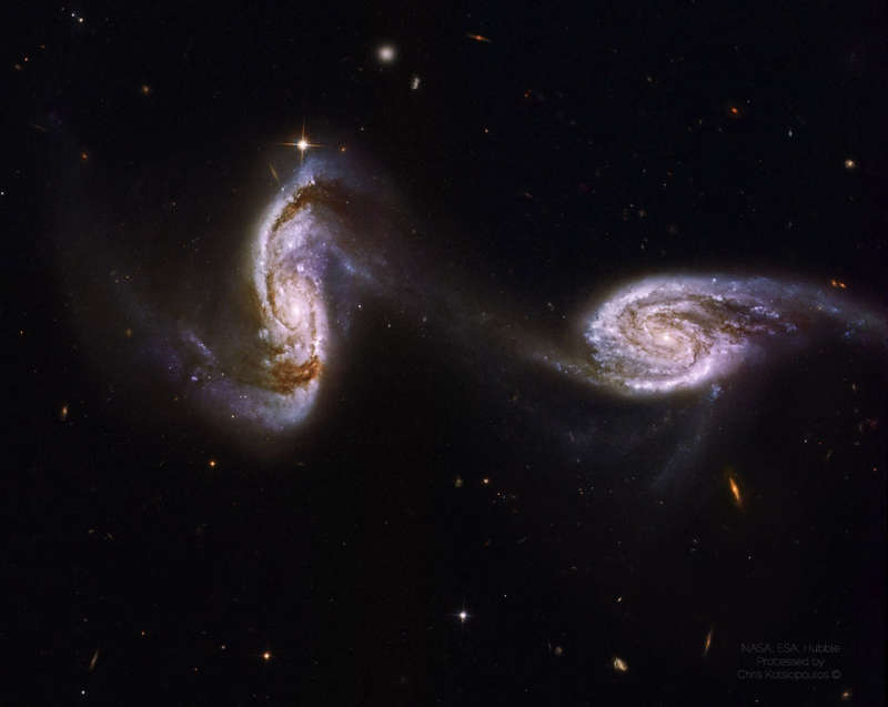 Arp 240: A Bridge between Spiral Galaxies from Hubble