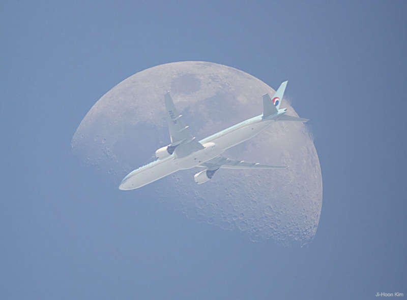 An Airplane in Front of the Moon