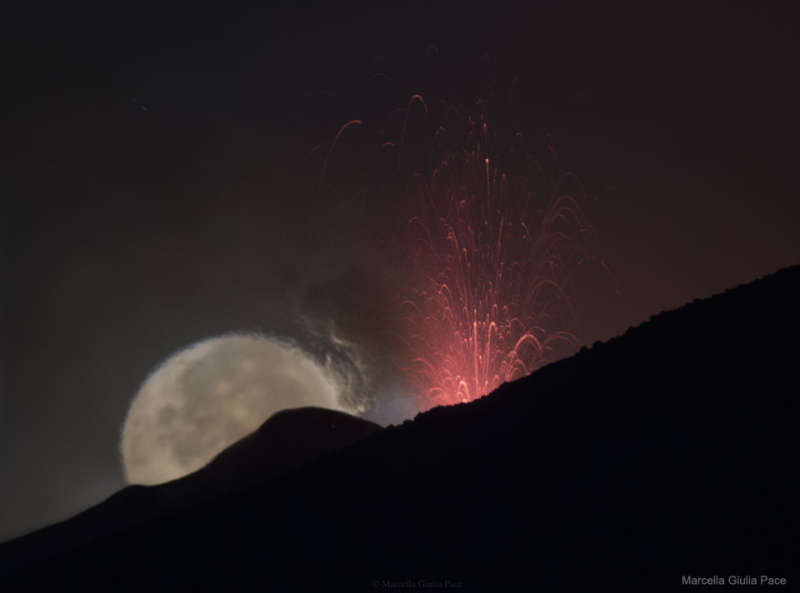 Moon behind Lava Fountain